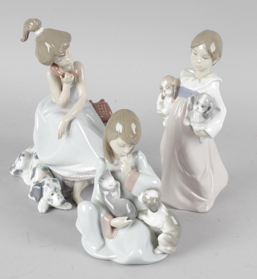 Five Lladro figurines. All featuring dogs or cats,