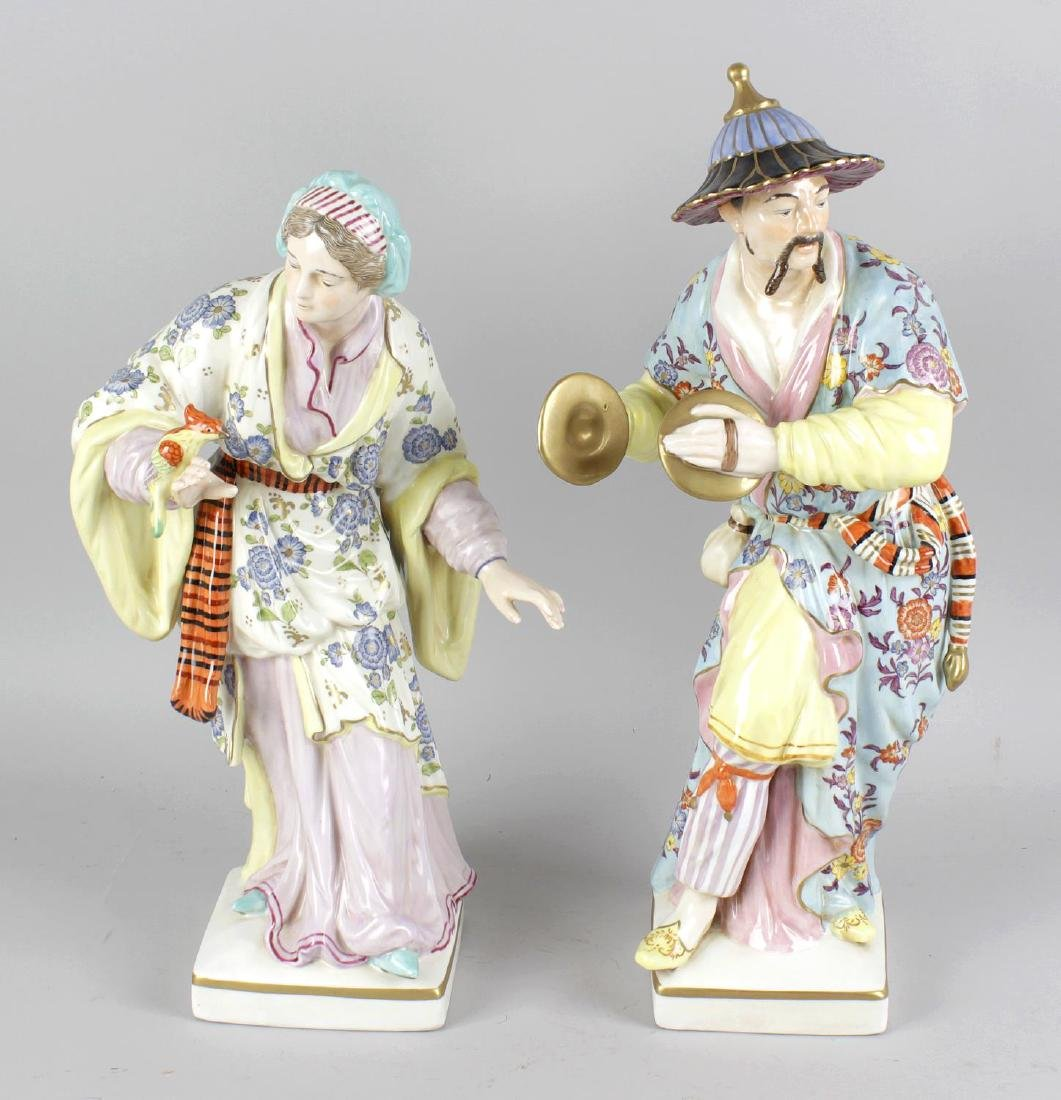 A pair of large German porcelain figurines, the first