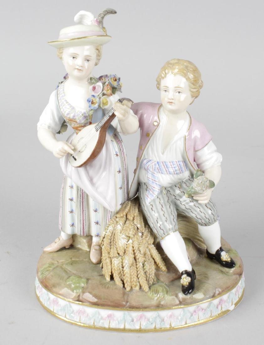A late 19th century Meissen porcelain figure group.