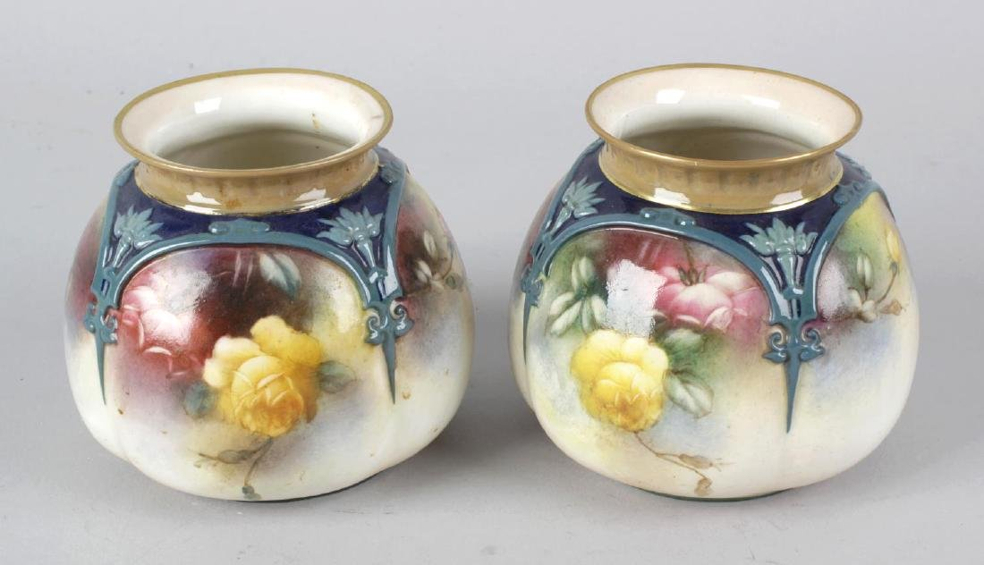 A pair of Hadley's Worcester bone china squat bulbous