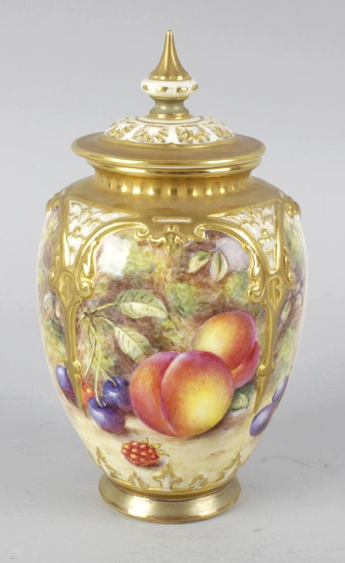 A Royal Worcester bone china vase with pierced cover,