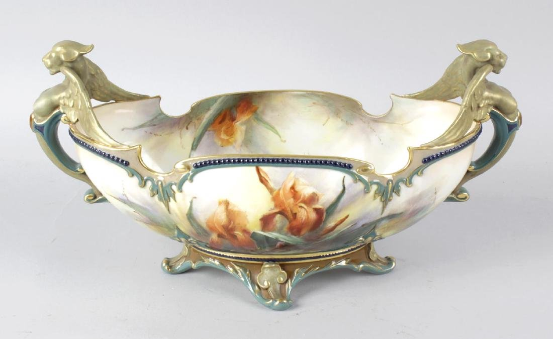 A Hadley's Worcester oval shaped bowl, the twin carry