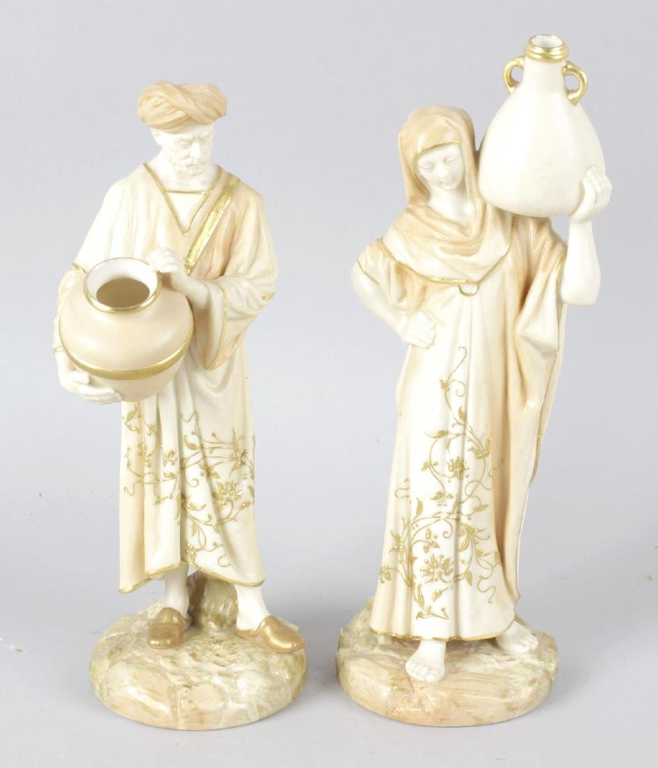 A pair of Royal Worcester bone china figurines,