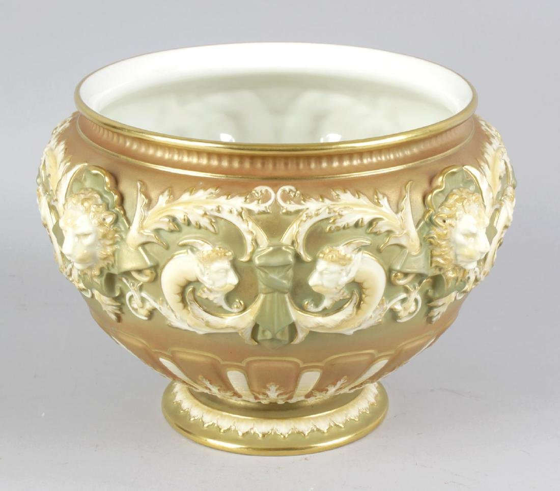 An unmarked Royal Worcester jardiniere, the ivory,