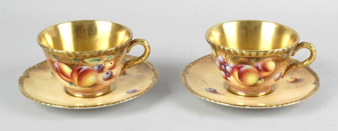 A pair of Royal Worcester porcelain fruit-painted tea