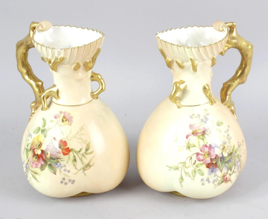 Four items of Royal Worcester blush ivory porcelain.