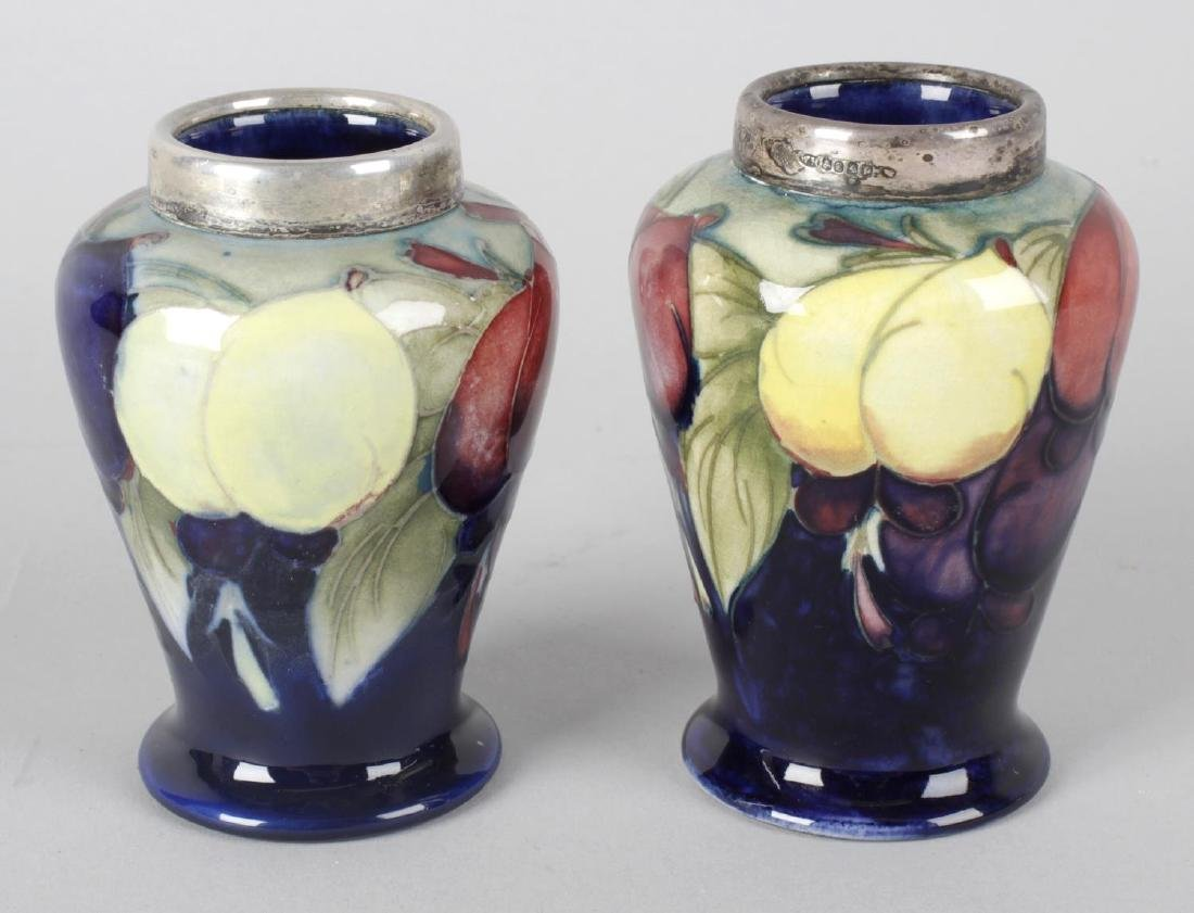Two Moorcroft pottery vases, each of baluster form,