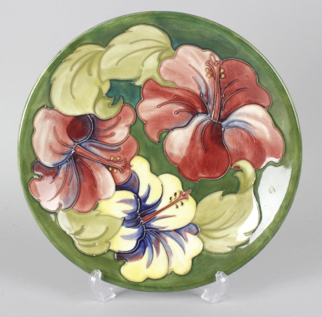 A Moorcroft pottery dish, the green glazed ground