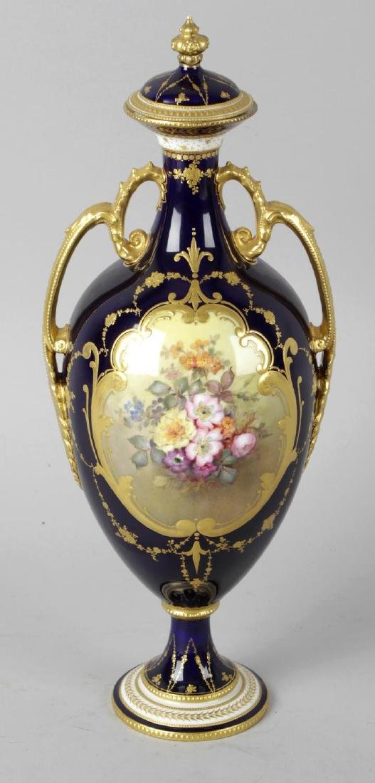 A Royal Crown Derby bone china twin handled vase and
