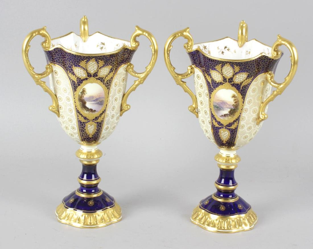 A pair of Coalport bone china three handled goblets,