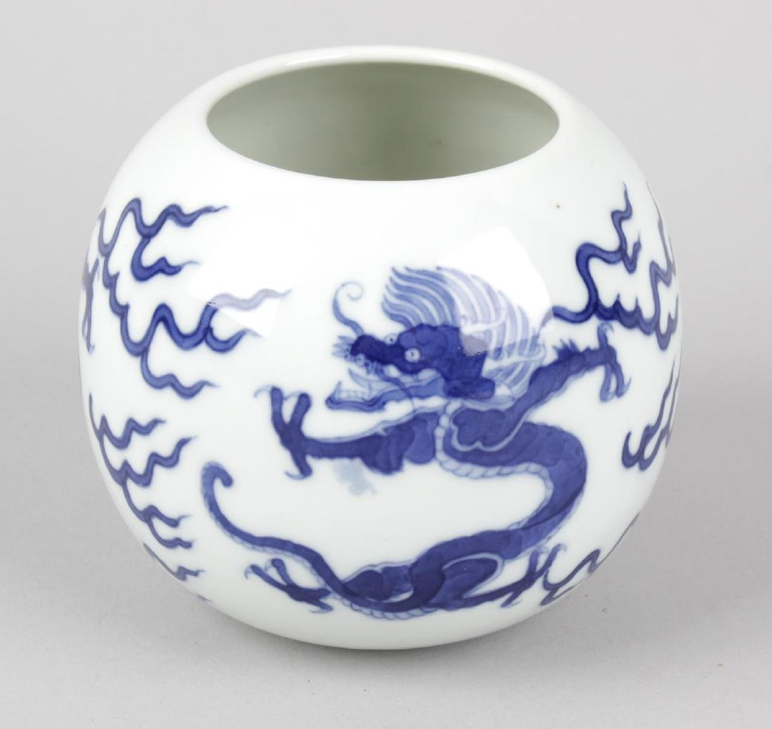 A Chinese spherical blue and white vase, the white