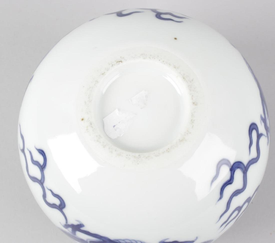 A Chinese spherical blue and white vase, the white - 2