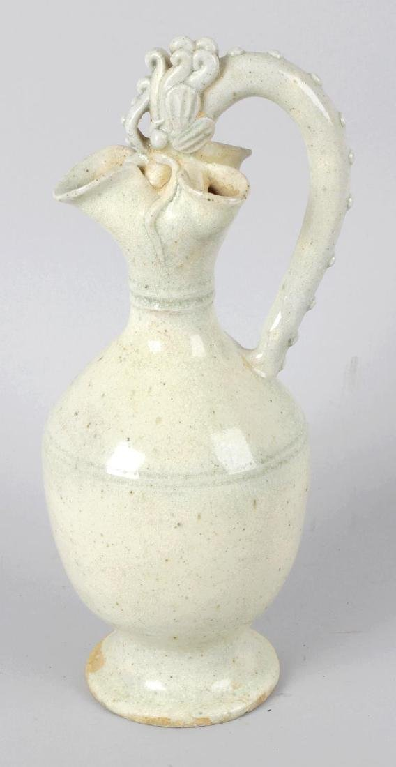 A Chinese Tang-style phoenix ewer. The ovoid body