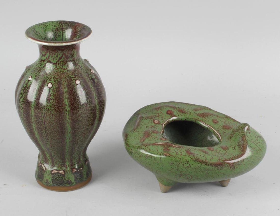 Two Chinese flambe-glazed pottery vases. Each with