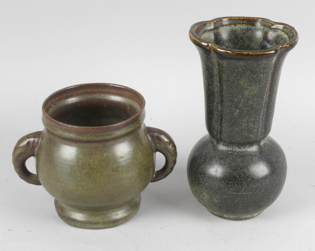 Two Chinese tea dust glazed pottery vases. The taller