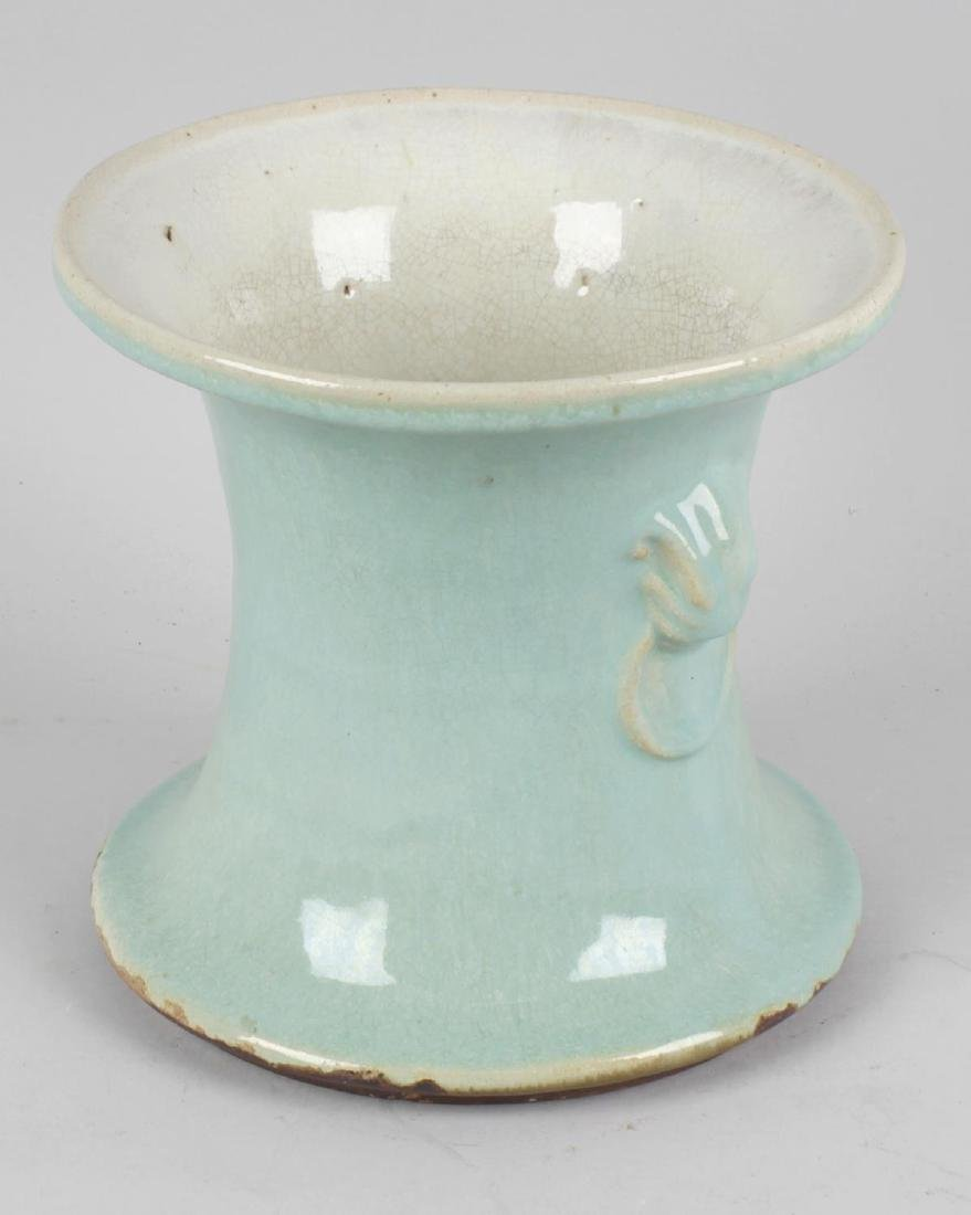A Chinese celadon glazed stoneware vase, the waisted
