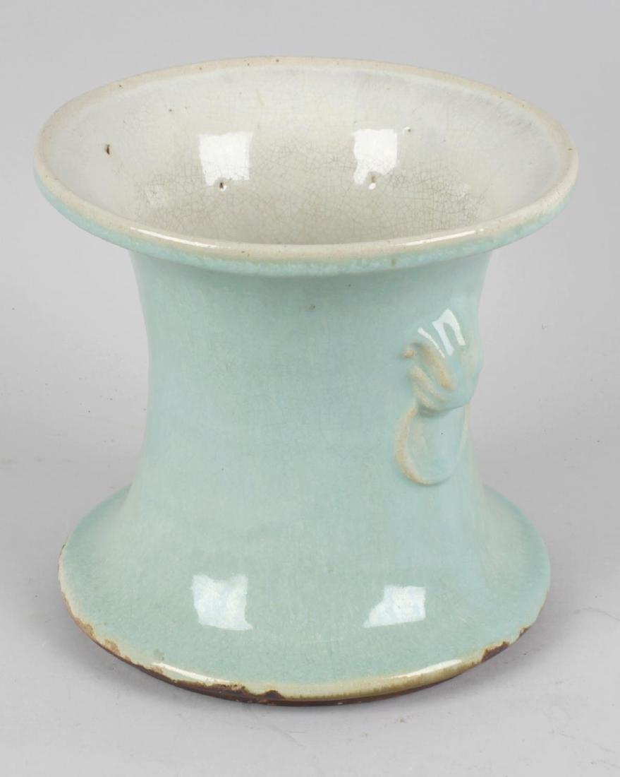 A Chinese celadon glazed stoneware vase, the waisted