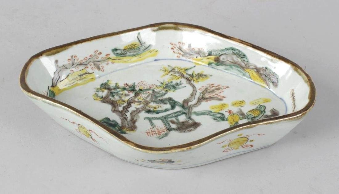 A Chinese porcelain serving dish. Of cartouche form