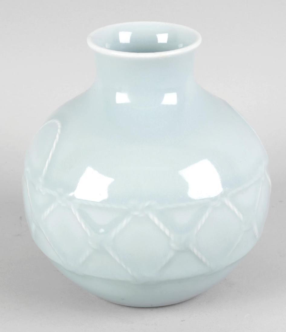A Chinese celadon-glazed porcelain vase. The spherical
