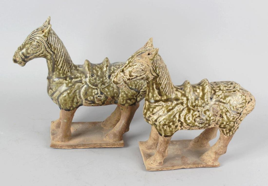 A pair of Chinese Han-style glazed terracotta horses.