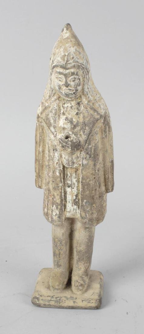 A Chinese terracotta figure of a soldier. Modelled with