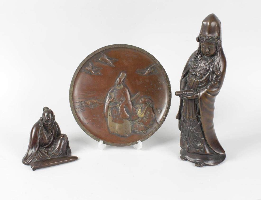 Four items of Oriental bronze. Comprising: a figure of
