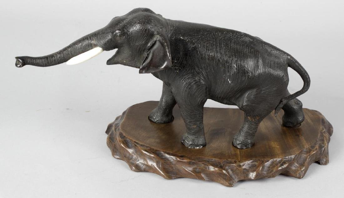 A Japanese Meiji period bronze and ivory study of an