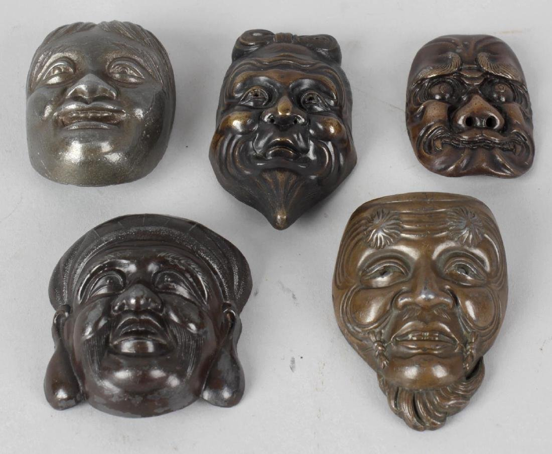 Five Japanese cast metal 'Noh' masks, four with applied