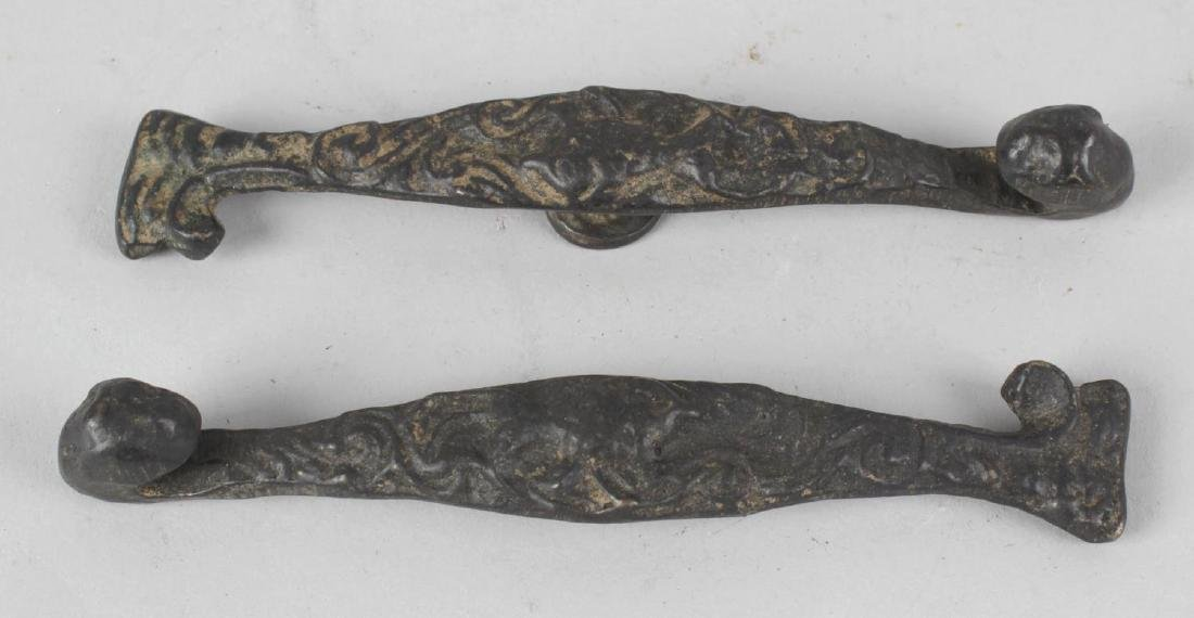 An interesting pair of Chinese bronze belt hooks. Each