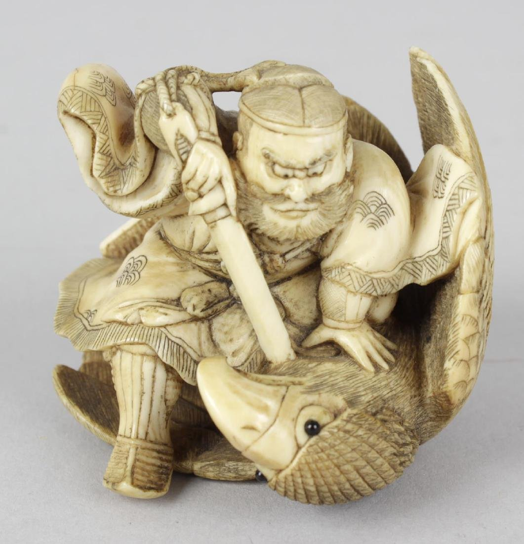 A good Japanese ivory netsuke of a warrior and eagle.