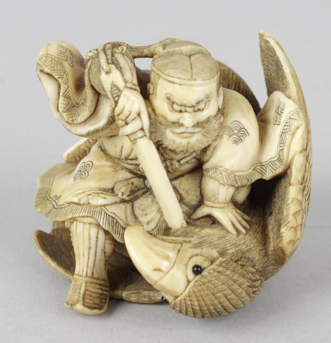 A good Japanese ivory netsuke of a warrior and eagle.