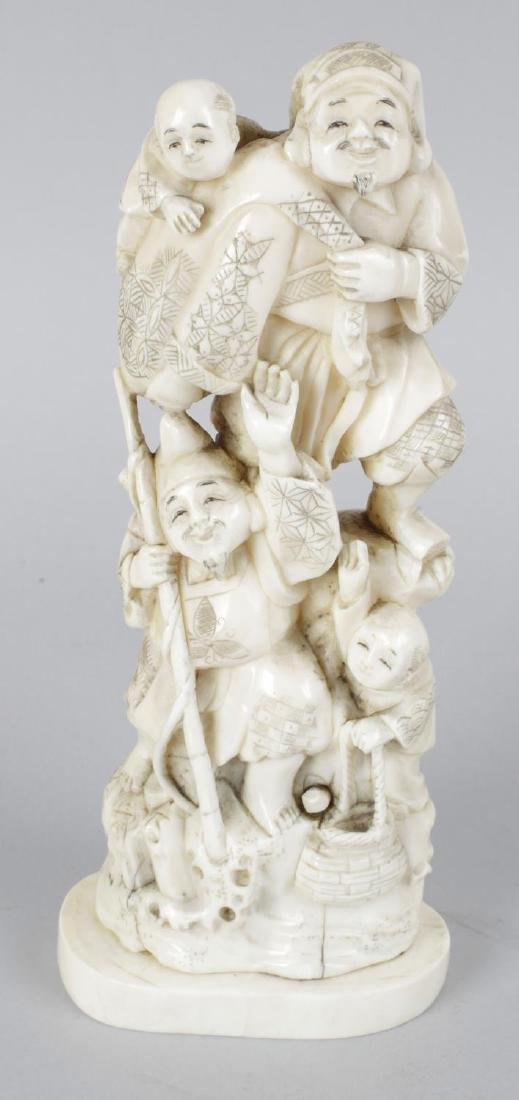 A 19th century carved ivory okimono modelled as a group