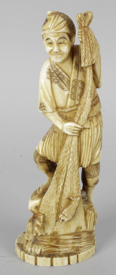 A late 19th century carved ivory okimono modelled as a