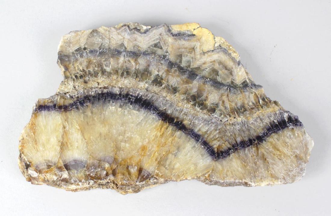 A Blue John raw specimen slice. Winnats One Vein with
