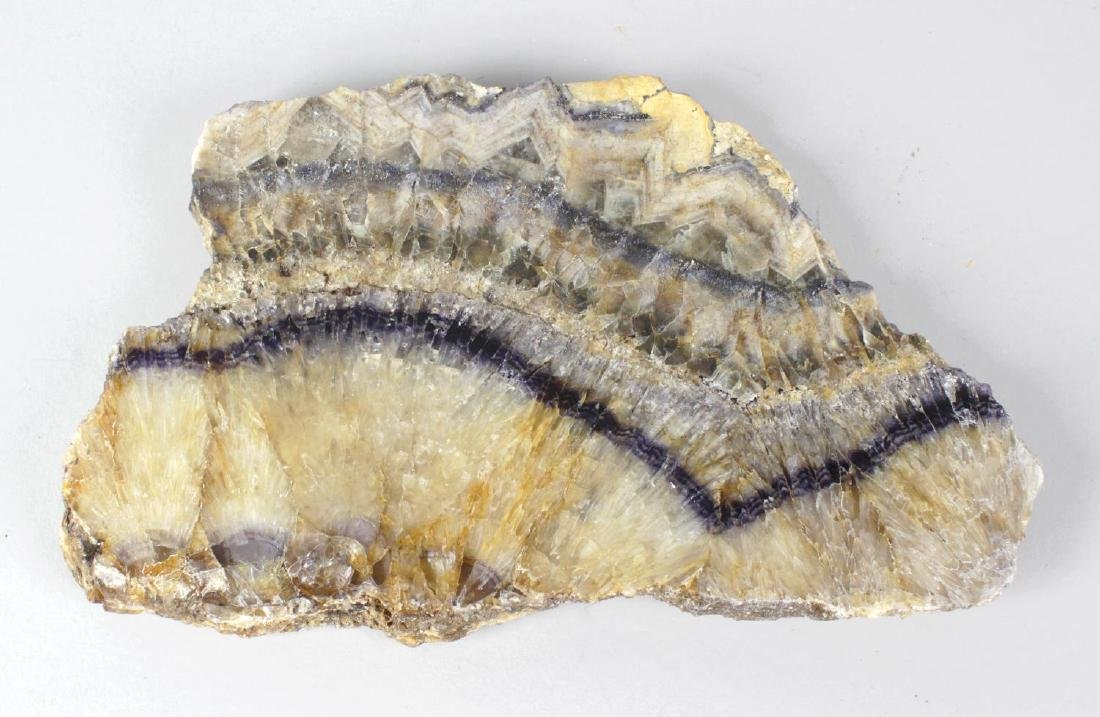 A Blue John raw specimen slice. Winnats One Vein with