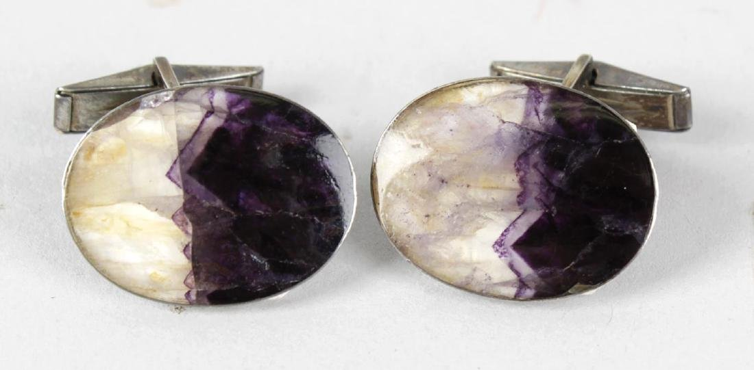 A pair of sterling silver-backed Blue John cufflinks.