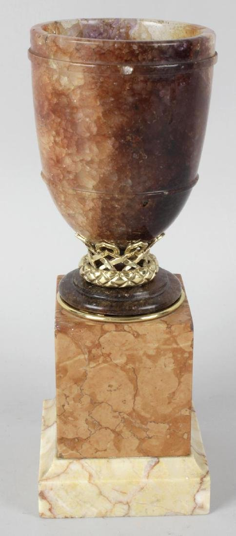 A fired Blue John urn. Probably 19th century, the ovoid