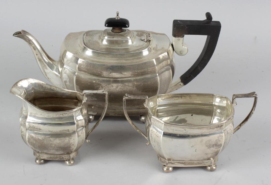 A George V silver three-piece tea set. Comprising tea