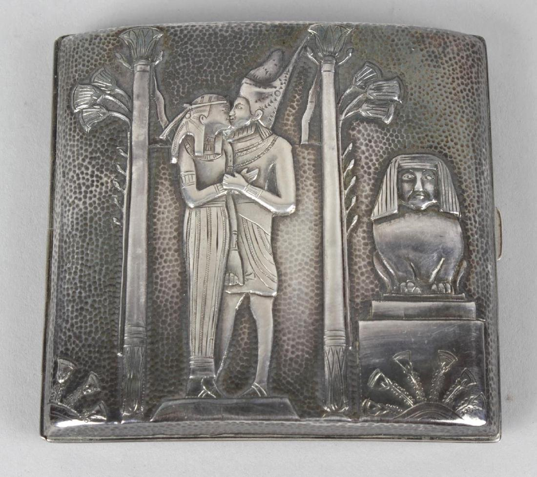 An early 20th century white metal cigarette case and