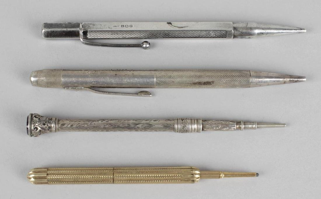 Two hallmarked silver cased propelling pencils, a white