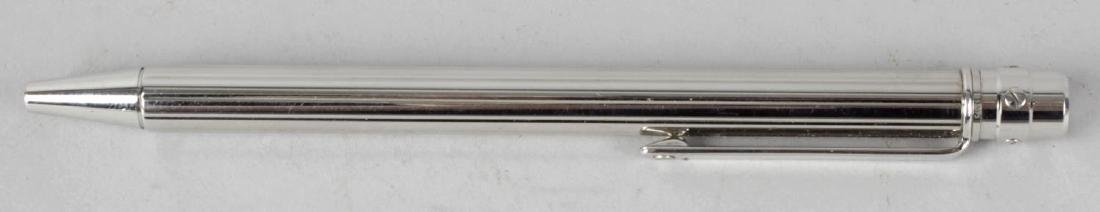 A Santos de Cartier ballpoint pen, with ribbed steel