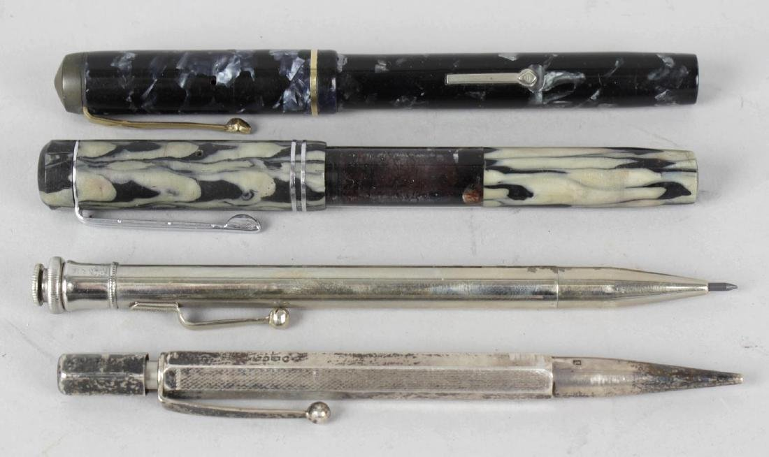 A collection of vintage pens and pencils, to include