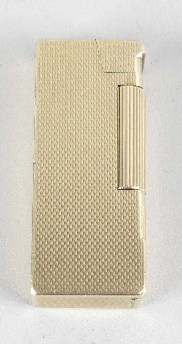 A Dunhill 9ct gold cigarette lighter, the body of