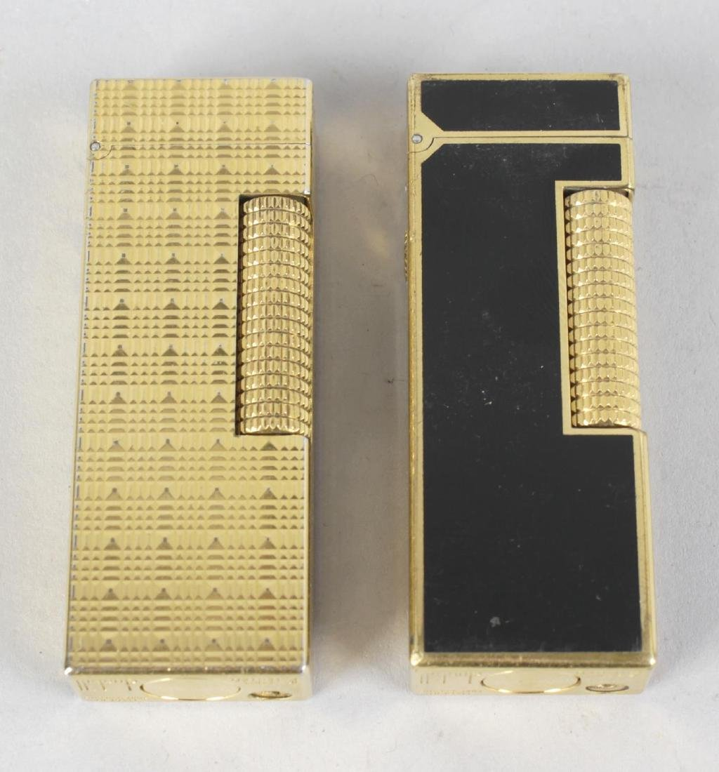Two Dunhill cigarette lighters, each of rectangular