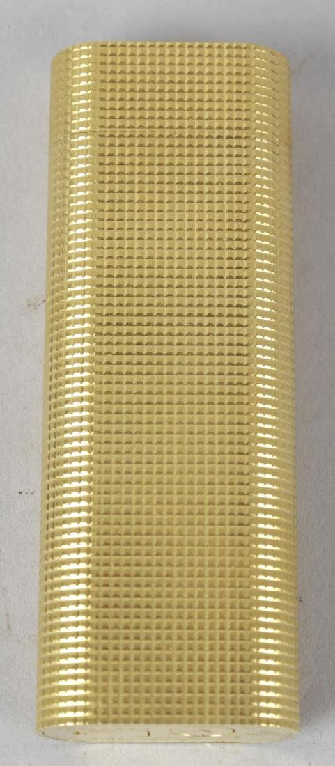 A Must de Cartier gold plated lighter, the rounded body