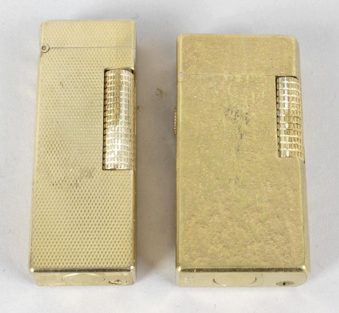 A Dunhill 70 cigarette lighter. The rectangular case
