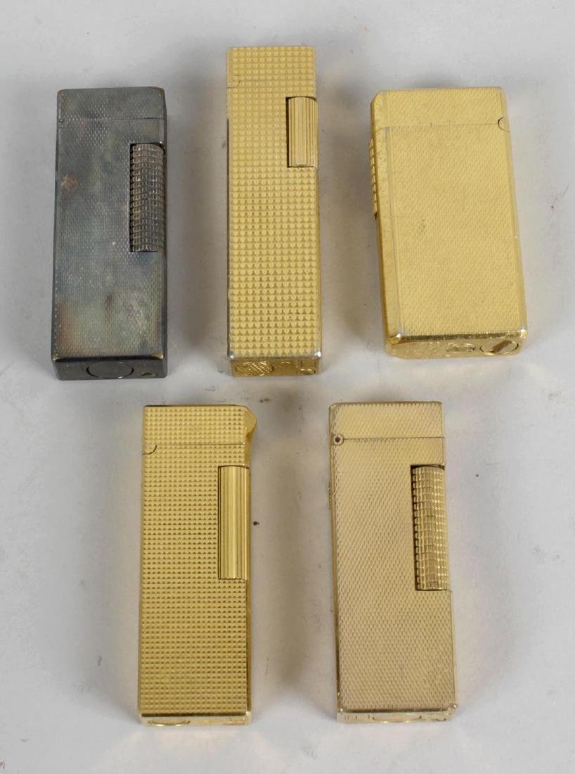 A selection of assorted lighters, to include a Dunhill