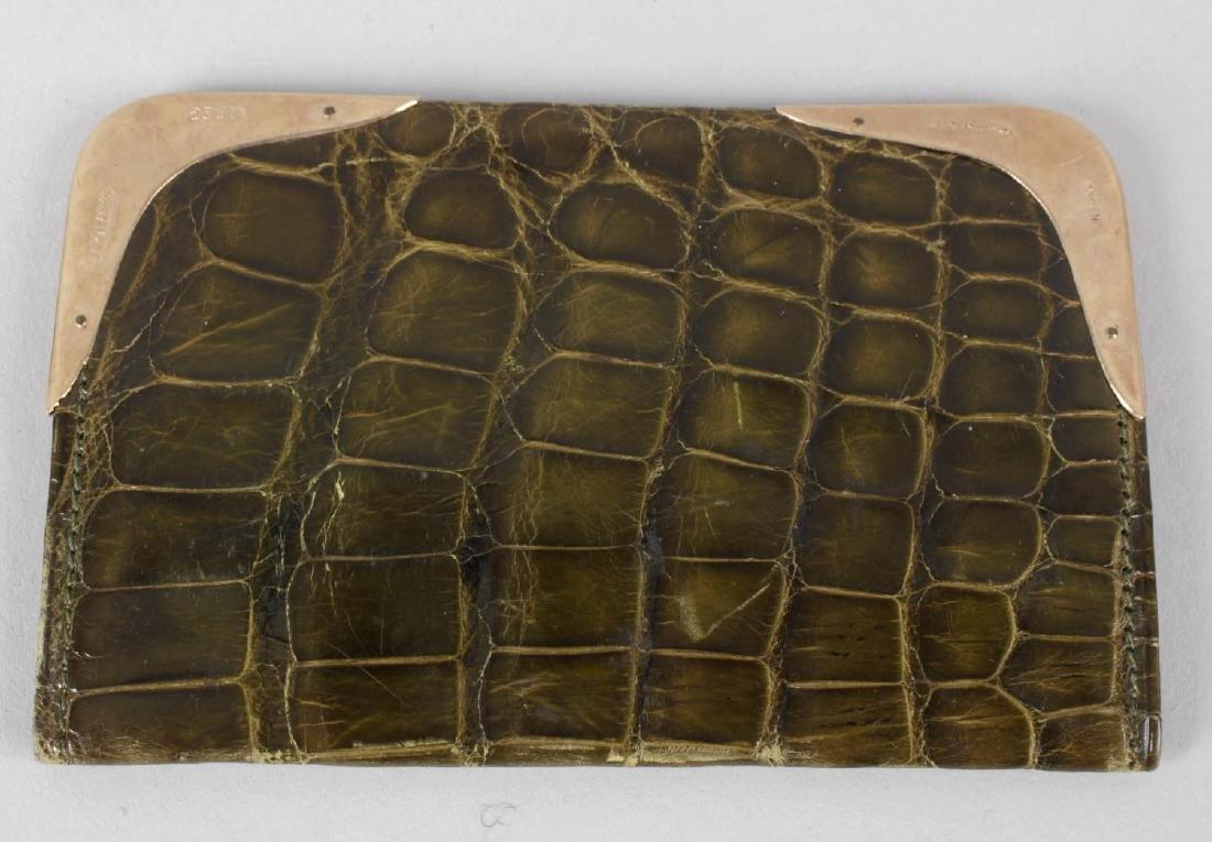An early 20th century gold-mounted crocodile skin