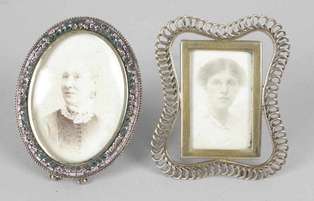 An oval easel style photograph frame, the border with