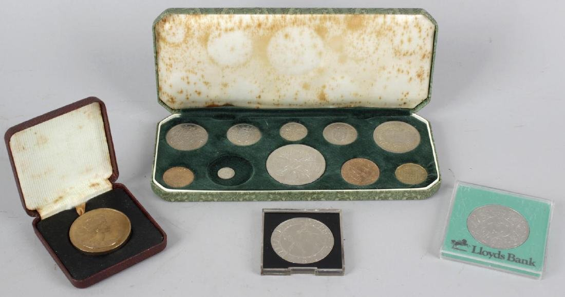 A box containing a 1900 Victorian silver crown, other